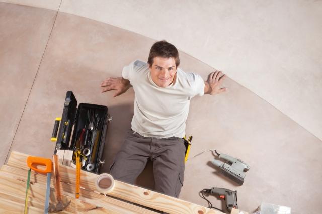 handy-crafts-man-sitting-inbetween-his-tools.jpg